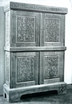 (5)	A chest of drawers made for an SS-Obergruppenführer in 1940, with florid Nazi symbolism. The main panels on the front represent the idealised peasant family, and the main theme of the symbolism in the animals and plants represented is fertility. Note the frieze with runic figures across the top of the chest, with the Nazi swastika in the centre. At the bottom left of the chest is a prominent sun symbol.